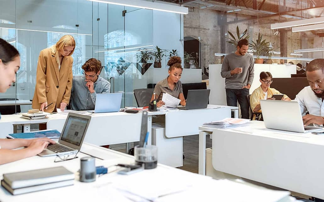 View of agency employees working at their desks